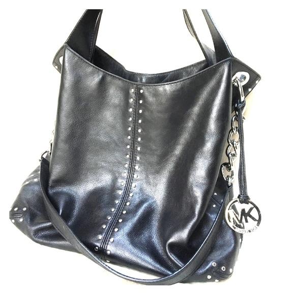 5b9c4884de3f Michael Kors riveted black leather purse. M_5c3a4055aaa5b8cd6e4438aa